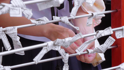 Omikuji - bad fortune papers at a Buddhist temple or Shinto Shrine Footage