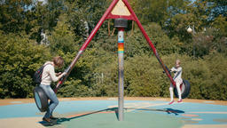 Family Lifestyle Activities: Daughter and Mother on the Playground on Seesaw Footage