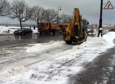 Excavator clears snow Stock Video Footage