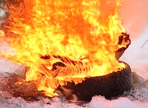 Burning tire cover Stock Video Footage