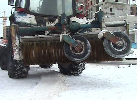 Brush On A Tractor For Cleaning Streets stock footage