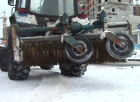 Brush on a tractor for cleaning streets Stock Video Footage
