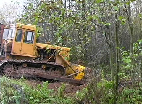 Bulldozer poured earth Stock Video Footage