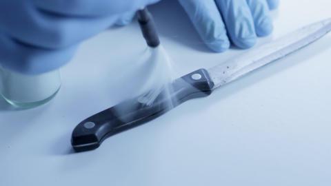 Tracking shot dusting knife for fingerprints Stock Video Footage