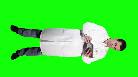 Young Doctor Scientist Full Body Tablet PC Greenscreen 12 Stock Video Footage