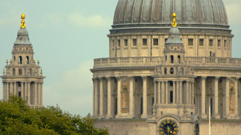 close-up of main dome of St. Paul's Cathedral and passing traffic in London Footage