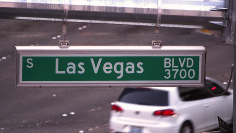 Static shot of Las Vegas street sign with cars passing through Footage