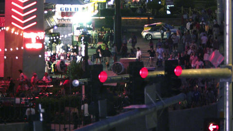 Traffic lights and neon signs above pedestrians on Las Vegas street Footage