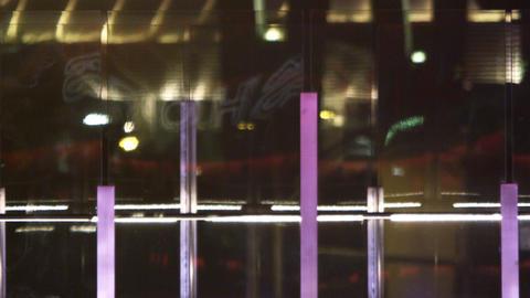 Close up of pedestrians on walkway at night in Las Vegas Footage