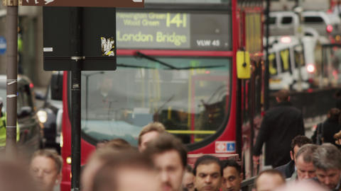 LONDON - OCTOBER 10: Double-decker stops on a busy street on October 10, 2011 in Footage