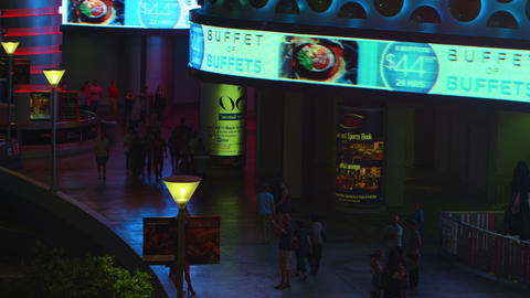 Nighttime footage of people walking along bright Las Vegas mall Footage