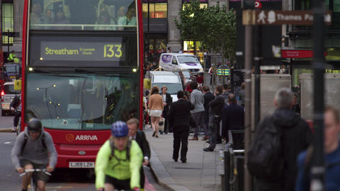 Double-decker and cyclists on a busy street Footage