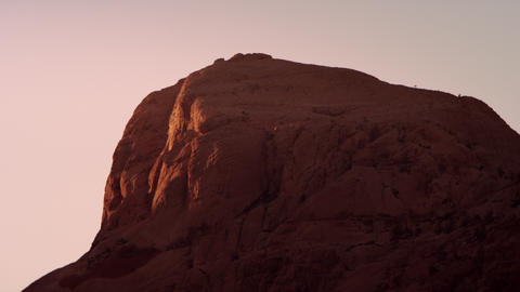 Sunset falling over red rock formation Footage