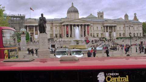 LONDON - OCTOBER 11: Unidentified people walk around Trafalgar Square, red bus p Footage