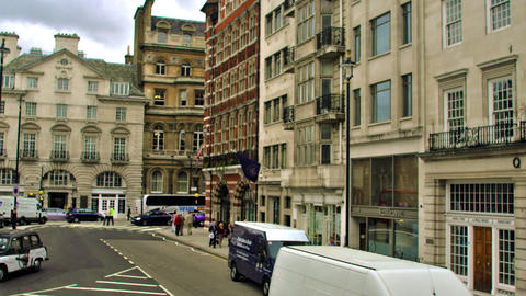 LONDON - OCTOBER 11: Unidentified people walk along streets with buildings in ba Footage