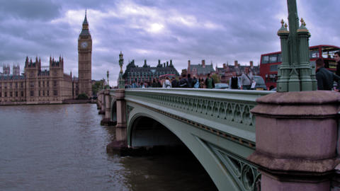 LONDON - OCTOBER 11: Unidentified people and cars cross bridge, big ben in backg Footage