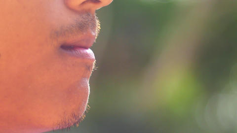 Close-up of a man lighting a cigarette and inhaling Footage