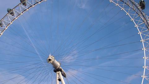 London eye against blue sky in London, England Footage