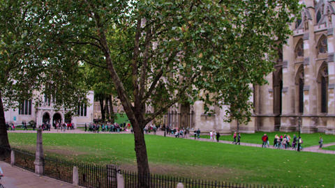 Crowd in courtyard in front of Westminster Abbey church in London, England Footage