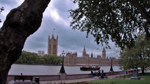 Westminster palace through trees from across river in London, England Footage