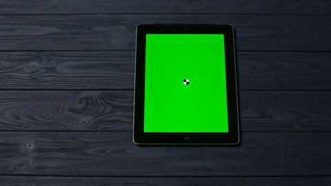 Black Tablet Pc on Dark Blue Table Live Action