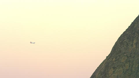 Aircraft descends behind Rio's Sugarloaf Mountain Footage