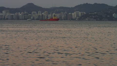 Pan of an evening view of a Rio coastline Footage