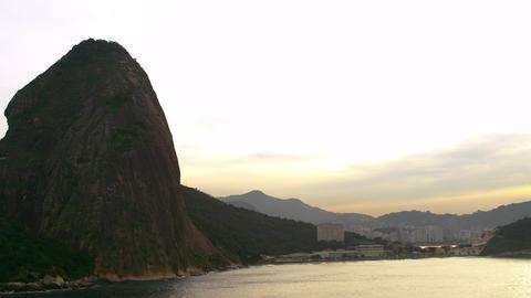 Aerial pan of mountain, bay, and cityscape - Rio de Janeiro, Brazil Footage