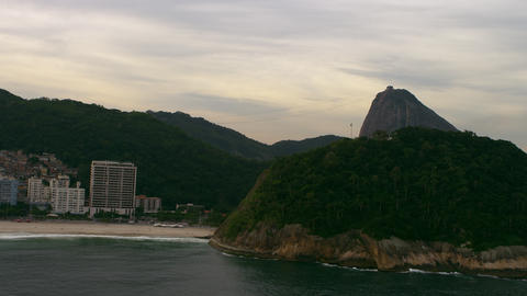 Aerial veiw of Rio de Janiero's beach, with a mountain to the right Footage
