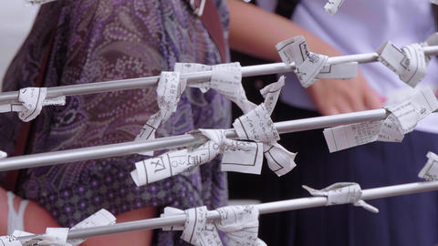 Omikuji - bad fortune papers at a Buddhist temple or Shinto Shrine Live Action