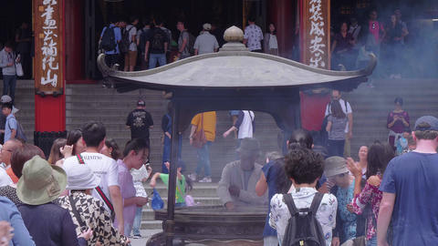 Religious Incent sticks burning in a kettle - Asakusa Temple Tokyo - TOKYO Live Action