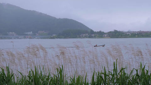 Lake Kawaguchiko at Mount Fuji in Japan - KAWAGUCHIKO, JAPAN - JUNE 17, 2018 Live Action
