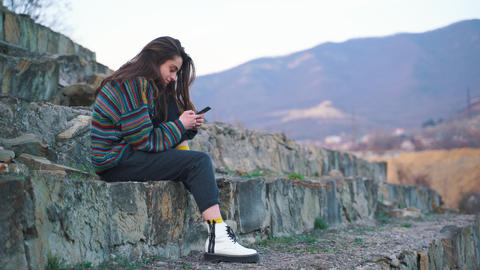 Girl Uses Mobile Phone Stock Video Footage