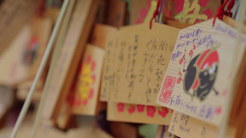 Wishes written on wooden plates in a Buddhist Temple in Japan - TOKYO, JAPAN - Live Action