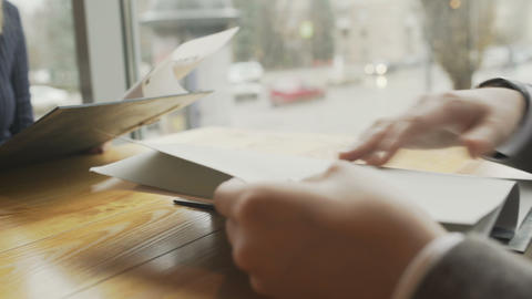 Woman reading menu on a dating in a restaurant Stock Video Footage