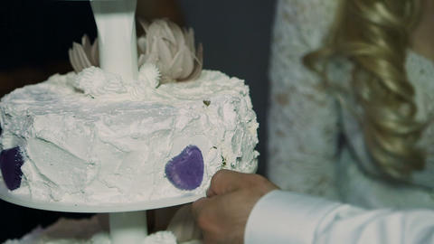 Detail of wedding cake cutting by newlyweds Wedding cake Live Action