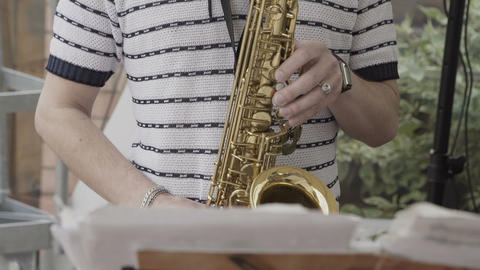 Saxophonist plays at the event Footage