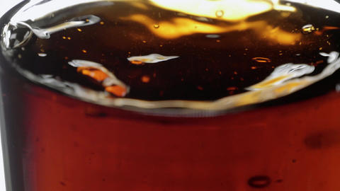 Refreshing Cola with ice cubes - close up slow motion shot Footage