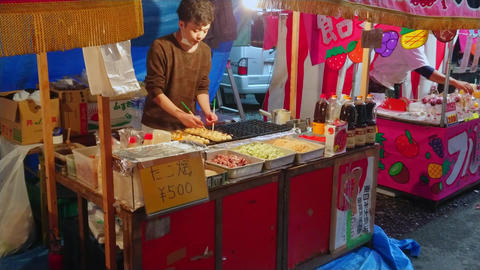 Preparation and street food sale of Japanese specialties - TOKYO, JAPAN - JUNE Footage