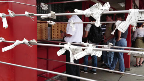 Omikuji - bad fortune papers at a Buddhist temple or Shinto Shrine - TOKYO Footage