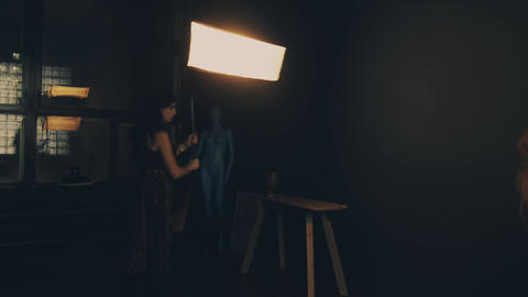 Photographer shooting a female photo model in a studio Live Action