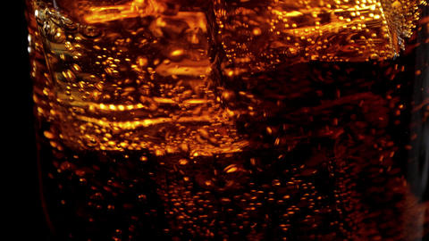 Amazing shot of ice cubes in Cola - perfect background of refreshing soda Footage