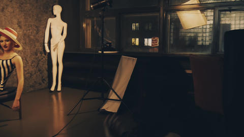 Photographer shooting a female photo model in a studio Footage