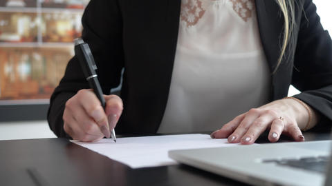 Businesswoman writing notes on the paper GIF