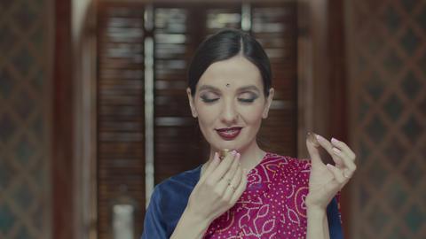 Delightful female enjoying flavor of dry perfume Live Action