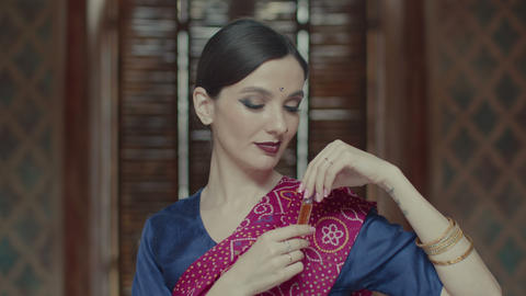 Charming woman opening bottle of oil perfume, Live Action