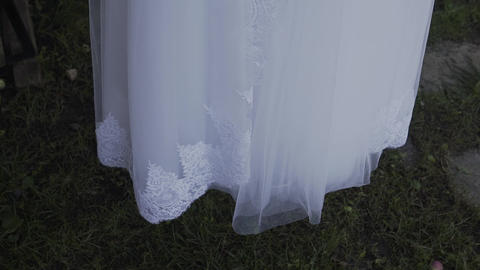White wedding dress hanging on a green tree, white... Stock Video Footage