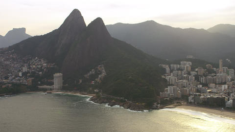 Slow panning aerial shot from downtown Rio de Janeiro to the Vidigal favela Footage