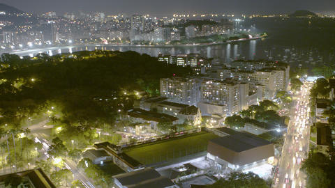 Time lapse overlooking busy streets and green hill at night in Rio de Janeiro, B Footage