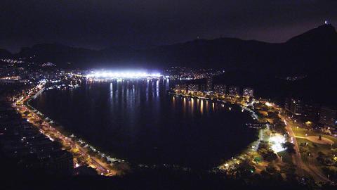 Pan of Lagoa Rodrigo de Freitas at night in Rio de Janeiro, Brazil Footage